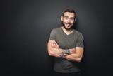 Joyful, handsome man on a black background - 176868092