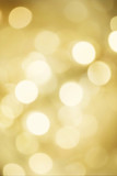 Golden blurred bokeh lights for Christmas and New Year celebration. Magical abstract glittery backgroun with falling snowflakes. - 176868490