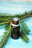 Essential oil and sprig of pine - 176868878