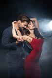 Sexy elegant couple. Woman wear re dress - 176873404