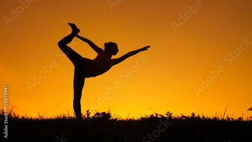 Naklejka Silhouette of woman doing yoga