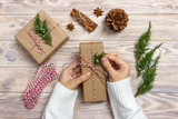 Gift wrapping. Woman packs gifts step by step - 176891264