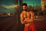 Handsome muscular man posing outside - 176892871