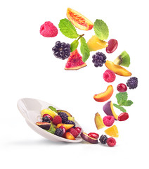fruit salad ingredients in the air in a bowl, isolated on a white background