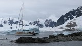The yacht stands near the glacier in the bay. Andreev. - 176901474