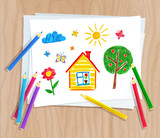 Color pencils lying on paper with child drawing - 176902687
