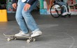 skateboard skate board friend behind disabled in wheelchair watching background copy space