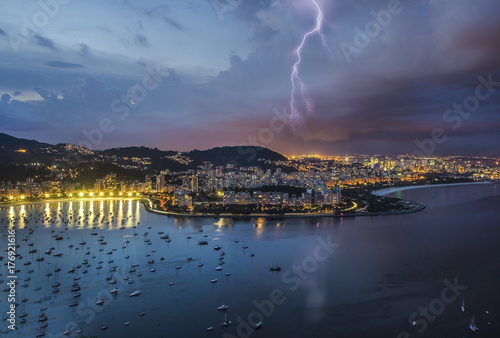 Lightning in the city of Rio, near the Sugar Loaf. Poster