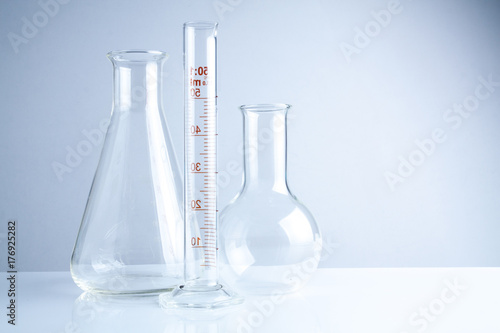 Laboratory glassware on table, Symbolic of science research.