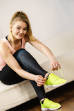 Woman putting sport shoes - 176925872