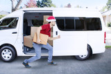 Courier shipping a package while running - 176929459