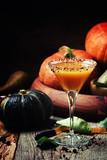 Halloween orange cocktail on a dark festive background, selective focus - 176935074