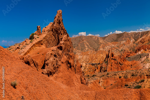 Foto op Canvas Baksteen Red rocks under the blue sky in the canyon Skazka, Kyrgyzstan