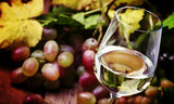 Dry white wine in glass, vintage wooden bakcground, selective focus - 176959295