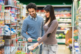 Couple shopping in a grocery store - 176962415