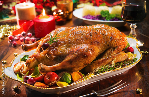 Roast Christmas duck with apples - 176966295