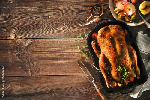 Roast Christmas duck with apples - 176966424