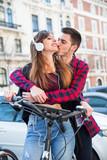 romantic couple in the street - 176969262