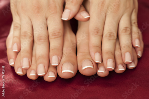 Tuinposter Pedicure feminine feet and hands with nicely fixed nails
