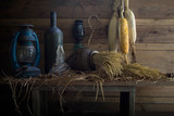 Still Life image of Lanterns and other things on the wooden plank in the old barn - 176974415