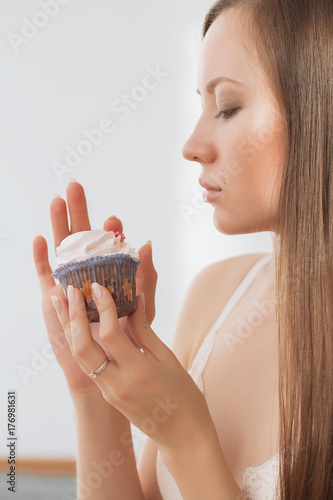 Woman wants to eat a cupcake Poster