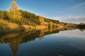 Autumn landscape on the river in the evening.