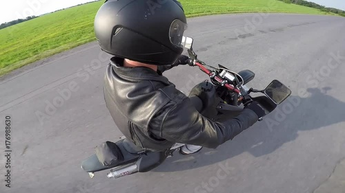 motorcycle rider changes gopro swivel from side to side