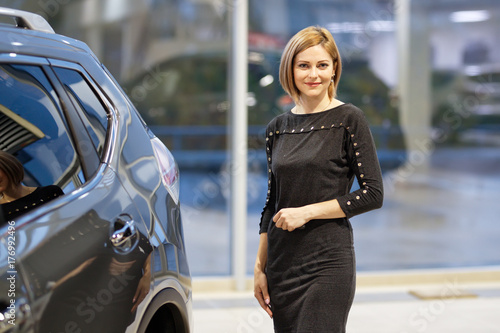 Fridge magnet Woman smiles in the background of dealership