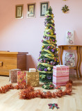 Decorated christmas tree with gifts in the room - 176996411