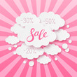 Paper clouds with sale message on pink background