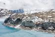 Quadro Glacier coming into Tilicho lake in Himalayas, Nepal. Mountain glacier melting into the highland lake. Melting glacier scenery.