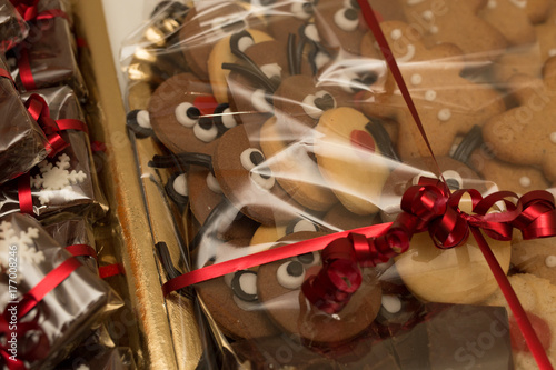 Christmas cakes as a gift with red bow Poster