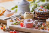 East sweets with candied fruits, nuts and sugar powder - 177021493
