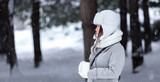 Woman in snowing weather in nature - 177023430