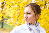 Young smiling teenage girl standing in autumn park - 177023849