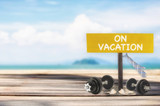 On vacation word on wooden sign on tropical beach background, happy holiday concept and work life balance idea - 177025464