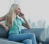Photo of a girl talking on the phone and looking out the window - 177032417