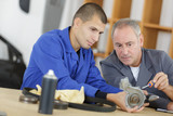 manager with apprentice holding bearing - 177033083