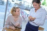 waitress taking the customer's order - 177033614