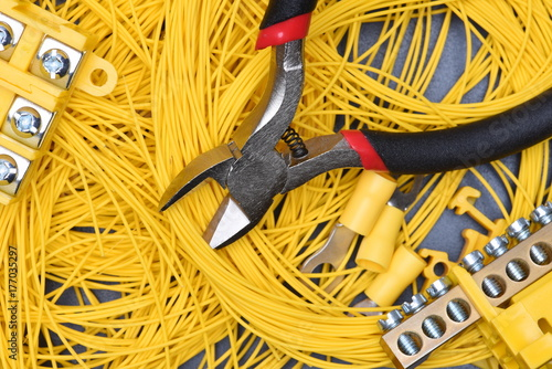 Cables, electrical equipment and tools on metal table , directly above Poster