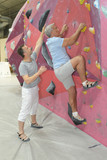 Senior man on indoor climbing wall - 177035813