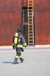 Quadro firefighter with the oxygen cylinder