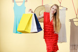Woman in shop picking clothes, sale concept - 177040003