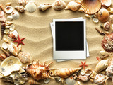 Pictue frame on shells and sand background. Copy space. - 177040066