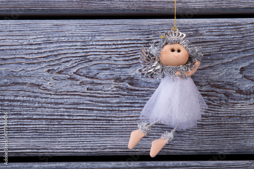 Angel ornament on wooden background Poster