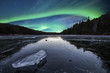 northern Lights above an icy lake