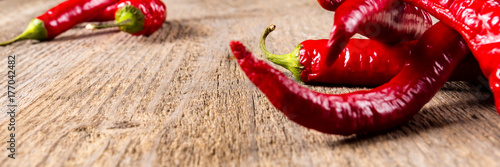 Chili. Red chili peppers on wooden table. Selective focus. Wide. Poster