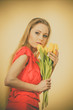 Lovely woman with yellow tulips bunch - 177046257