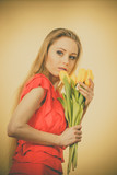 Lovely woman with yellow tulips bunch