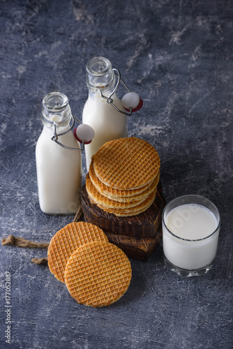 Foto op Aluminium Milkshake Glass of milk and waffle with jam